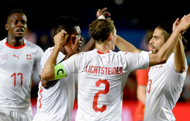 Switzerland celebrate a goal against Spain